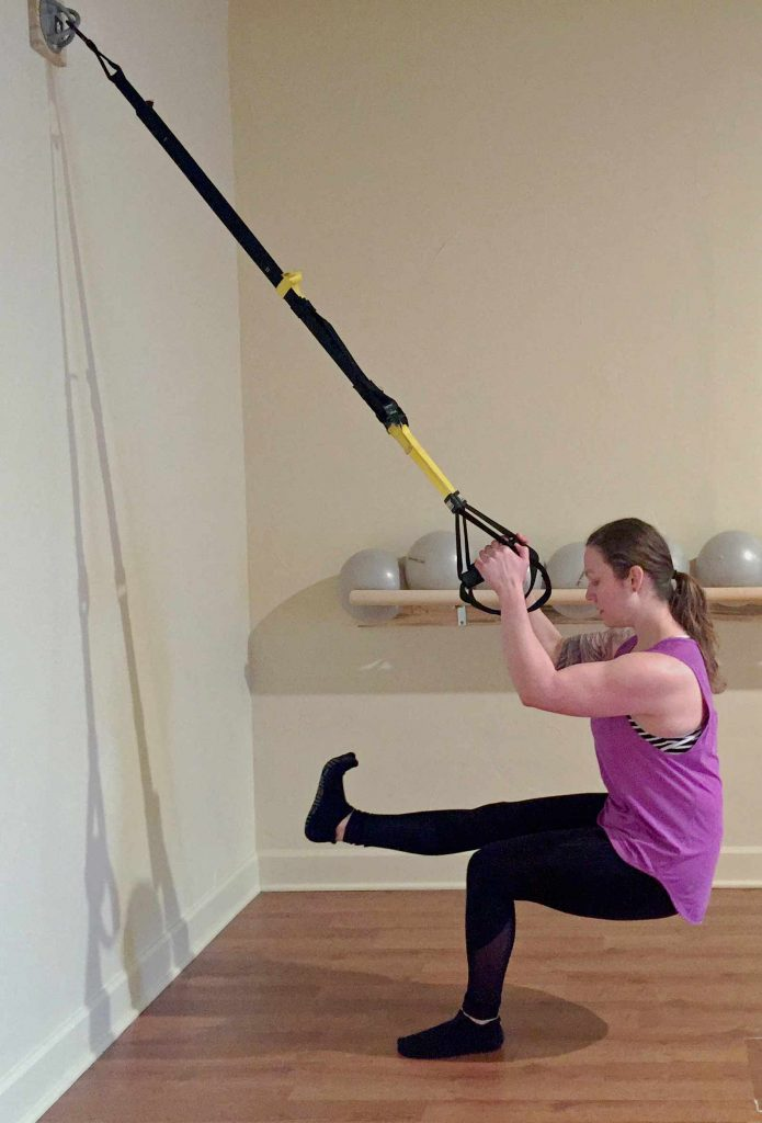 Nicole Adams of Origin House of Fitness using the new TRX setup in Fort Collins Colorado