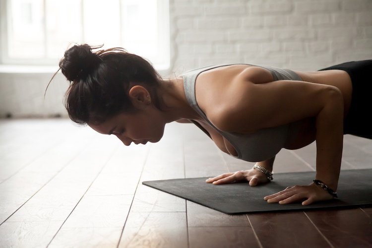Origin House of Fitness mock photo of woman doing plank on yoga mat