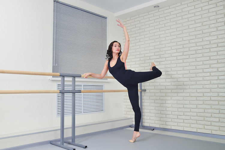 Origin House of Fitness mock photo of woman doing barre fitness move