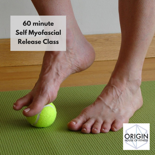 origin house of fitness classical mat pilates in studio using tennis ball on foot