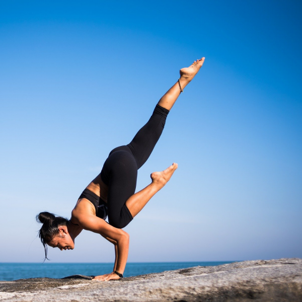 woman doing a handstand yoga pose