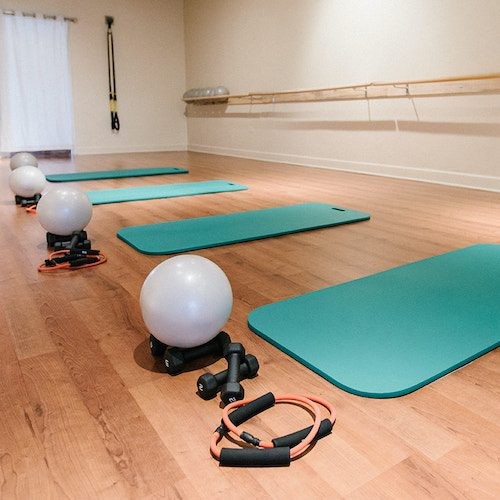 Inside Origin House of Fitness Pilates Barre Yoga Studio Fort Collins Colorado Studio setup for barre fitness class